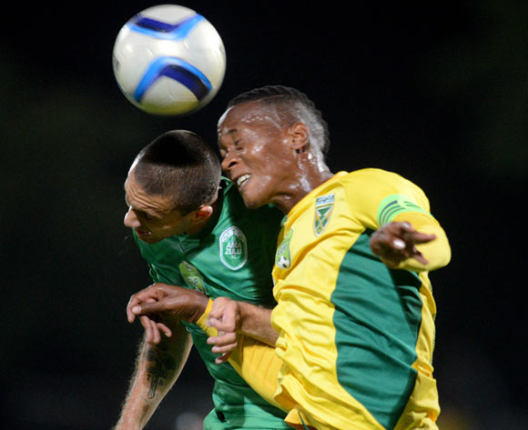 Matome Mathiane of Golden Arrows battles Roscoe Pietersen of AmaZulu during the 2015 Nedbank Cup football match between AmaZulu and Golden Arrows at the Princess Magogo Stadium in Durban on the 20th of February 2015