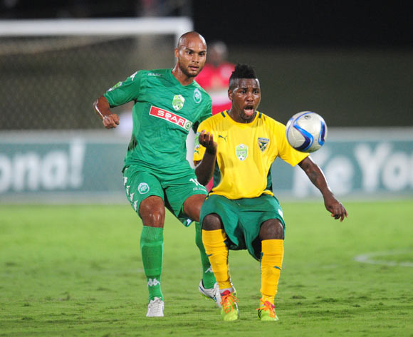 Robyn Johennes of AmaZulu battles Mabhudi Khenyeza of Golden Arrows during the 2015 Nedbank Cup football match between AmaZulu and Golden Arrows at the Princess Magogo Stadium in Durban on the 20th of February 2015