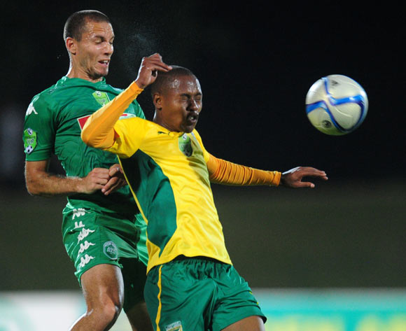 Roscoe Pietersen of AmaZulu and Sibusio Sibeko of Golden Arrows during the 2015 Nedbank Cup football match between AmaZulu and Golden Arrows at the Princess Magogo Stadium in Durban on the 20th of February 2015