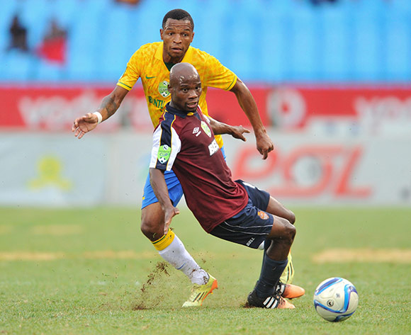 Mzikayise Mashaba of Mamelodi Sundowns challenged by Sandile Mazibuko of Thanda Royal Zulu during the Nedbank Cup Last 32 match between Mamelodi Sundowns and Thanda Royal Zulu at Loftus Stadium in Pretoria, South Africa on February 21, 2014 ©Samuel Shivambu/BackpagePix