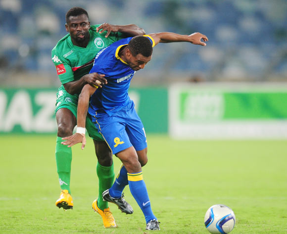 Sedate Ouro Akoriko of AmaZulu battles Mzikayise Mashaba of Mamelodi Sundowns during the Absa Premiership 2014/15 football match between AmaZulu and Mamelodi Sundowns at the Moses Mabhida Stadium in Durban Kwa-Zulu Natal on the 24th of February 2015