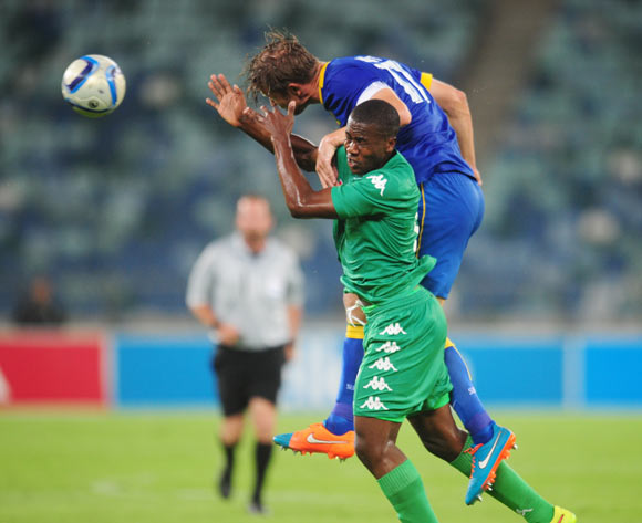 Bonginkosi Ntuli of AmaZulu battles Alje Schut of Mamelodi Sundowns during the Absa Premiership 2014/15 football match between AmaZulu and Mamelodi Sundowns at the Moses Mabhida Stadium in Durban Kwa-Zulu Natal on the 24th of February 2015