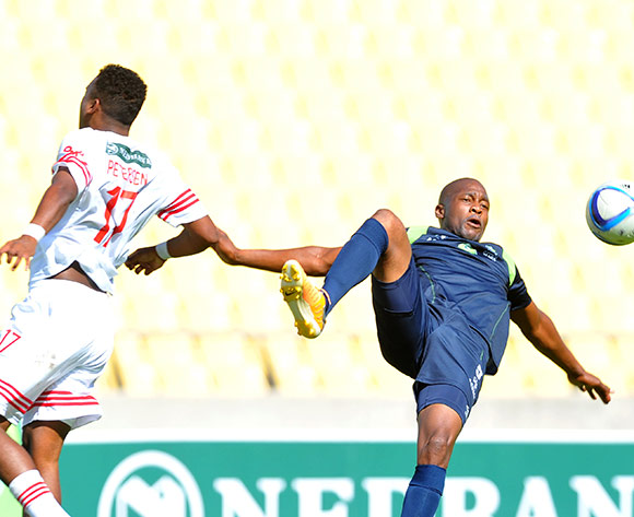 Gift Sithole of Platinum Stars challenged by Shane Petersen of The Magic during the Nedbank Cup Last 32 match between Platinum Stars and The Magic at Royal Bafokeng Stadium in Rustenburg, South Africa on February 22, 2014 ©Samuel Shivambu/BackpagePix