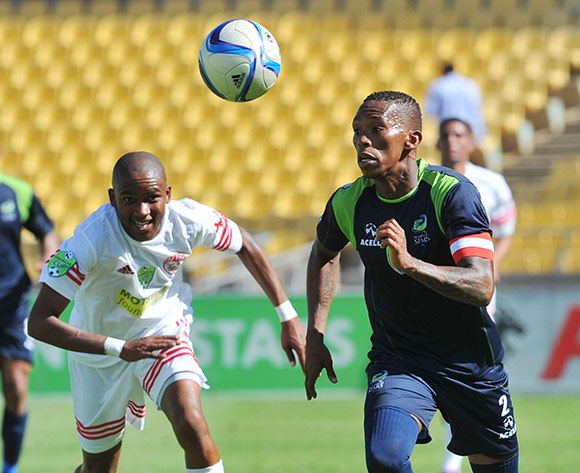Vuyo Mere of Platinum Stars challenged by Siyanda Maqungo of The Magic during the Nedbank Cup Last 32 match between Platinum Stars and The Magic at Royal Bafokeng Stadium in Rustenburg, South Africa on February 22, 2014 ©Samuel Shivambu/BackpagePix