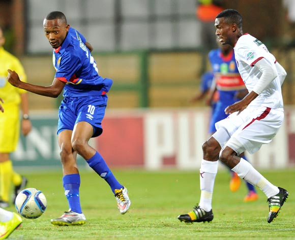 Thabo Mnyamane of University Pretoria challenged by Lucky Baloyi of Moroka Swallows during the Nedbank Cup Last 32 match between University of Pretoria and Moroka Swallows at Tuks Stadium in Pretoria, South Africa on February 25, 2015