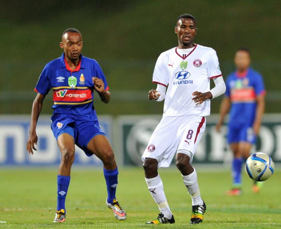 Lucky Baloyi of Moroka Swallows challenged by Thabo Mnyamane of University Pretoria during the Nedbank Cup Last 32 match between University of Pretoria and Moroka Swallows at Tuks Stadium in Pretoria, South Africa on February 25, 2015