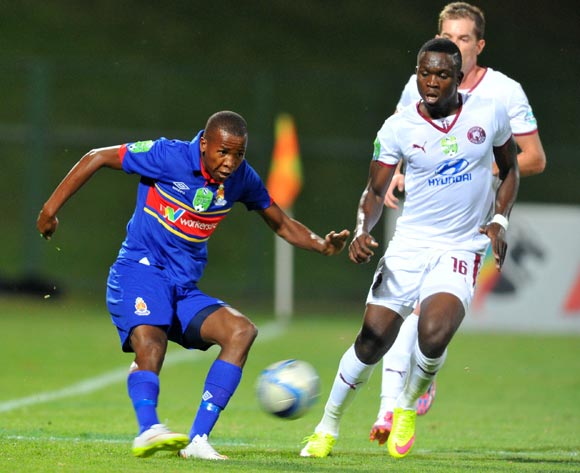 Thabo Mosadi of University Pretoria challenged by Luyolo Nomandela of Moroka Swallows during the Nedbank Cup Last 32 match between University of Pretoria and Moroka Swallows at Tuks Stadium in Pretoria, South Africa on February 25, 2015