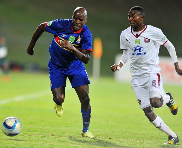 Geofrey Massa of University Pretoria challenged by Lucky Baloyi of Moroka Swallows during the Nedbank Cup Last 32 match between University of Pretoria and Moroka Swallows at Tuks Stadium in Pretoria, South Africa on February 25, 2015