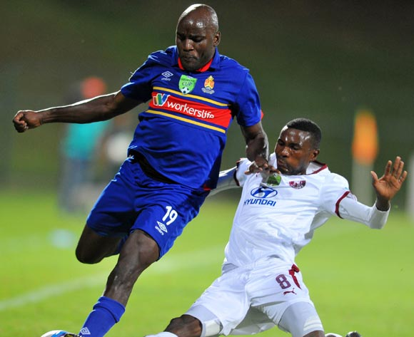 Geofrey Massa of University Pretoria tackled by Lucky Baloyi of Moroka Swallows during the Nedbank Cup Last 32 match between University of Pretoria and Moroka Swallows at Tuks Stadium in Pretoria, South Africa on February 25, 2015