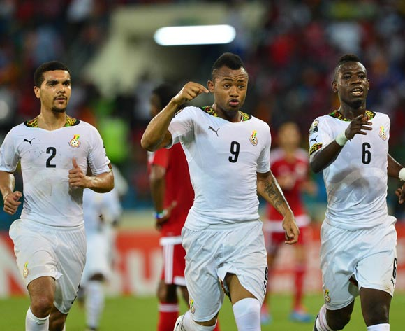 Jordan Ayew of Ghana (c)  celebrates his goal Kwesi Appiah (l) and Afriyie Acquah (r)  join in during the 2015 Africa Cup of Nations semifinal football match between Ghana and Equatorial Guinea at the Malabo Stadium, Malabo, Equatorial Guinea on 5 February  2015