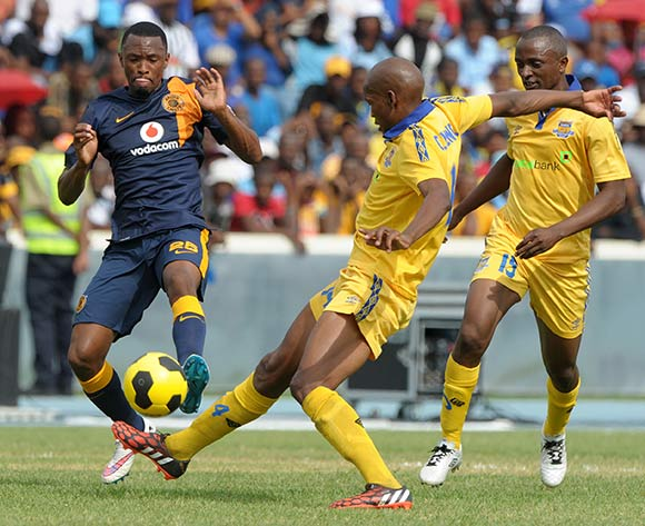 Bernard Parker of Kaizer Chiefs challenged by Oscar Ncenga of Township Rollers during the 2015 CAF Champions League match between Township Rollers and Kaizer Chiefs at the National Stadium, Lobatse on the 28 February 2015  ©Muzi Ntombela/BackpagePix