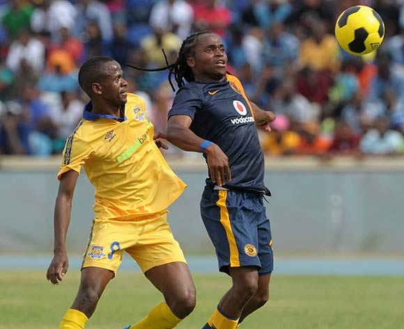 Siphiwe Tshabalala of Kaizer Chiefs battles with Sikele Motsholetsi of Township Rollers during the 2015 CAF Champions League match between Township Rollers and Kaizer Chiefs at the National Stadium, Lobatse on the 28 February 2015  ©Muzi Ntombela/BackpagePix