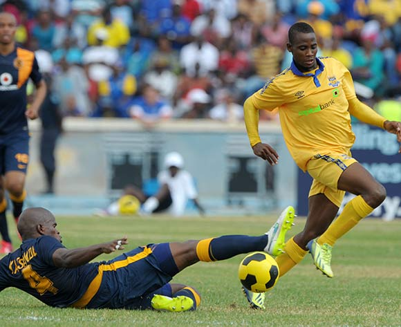 Boy Segolame of Township Rollers tackled by Willard Katsande of Kaizer Chiefs  during the 2015 CAF Champions League match between Township Rollers and Kaizer Chiefs at the National Stadium, Lobatse on the 28 February 2015  ©Muzi Ntombela/BackpagePix
