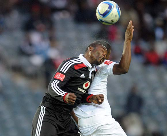 Puleng Tlolane of Polokwane City battles with Rooi Mahamutsa of Orlando Pirates during the Absa Premiership match between Orlando Pirates and Polokwane City on 28 February 2015 at Orlando Stadium Pic Sydney Mahlangu/BackpagePix