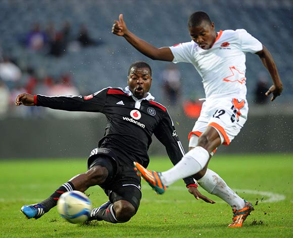 Puleng Tlolane of Polokwane City is tackled by Rooi Mahamutsa of Orlando Pirates during the Absa Premiership match between Orlando Pirates and Polokwane City on 28 February 2015 at Orlando Stadium Pic Sydney Mahlangu/BackpagePix