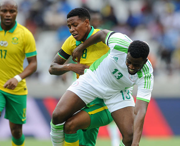 Akpan Hope Ini Ita of Nigeria battles with Bongani Zungu of South Africa during the International Friendly match between South Africa and Nigeria at the Mbombela Stadium, Mbombela on the 29 March 2015  ©Muzi Ntombela/BackpagePix