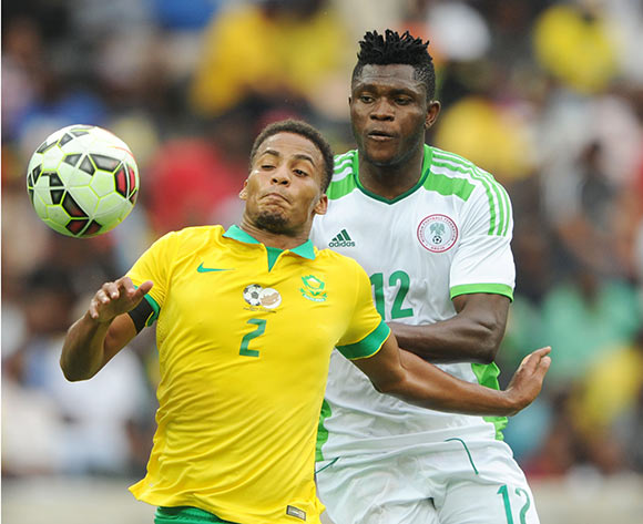Rivaldo Coetzee of South Africa challenged by Olanare Aaron Samuel of Nigeria during the International Friendly match between South Africa and Nigeria at the Mbombela Stadium, Mbombela on the 29 March 2015  ©Muzi Ntombela/BackpagePix