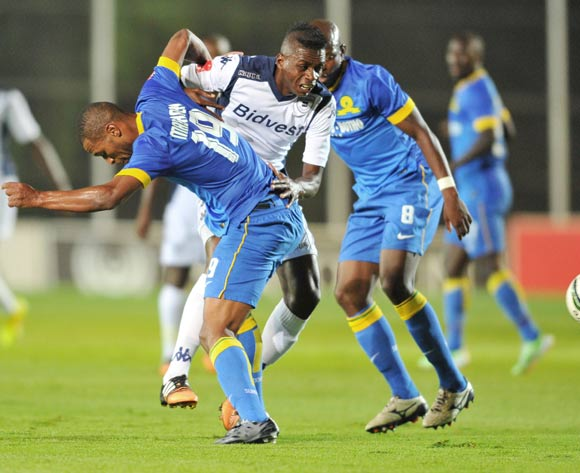 Papy Faty of Bidvest Wits challenged by Mzikayise Mashaba of Mamelodi Sundowns during the Absa Premiership 2014/15 football match between Bidvest Wits and Mamelodi Sundowns at Bidvest Stadium in Johannesburg, South Africa on March 03, 2015