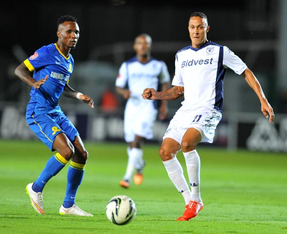 Henrico Botes of Bidvest Wits challenged by Teko Modise of Mamelodi Sundowns during the Absa Premiership 2014/15 football match between Bidvest Wits and Mamelodi Sundowns at Bidvest Stadium in Johannesburg, South Africa on March 03, 2015