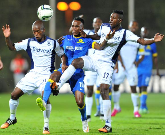 Teko Modise of Mamelodi Sundowns challenged by Phumlani Ntshangase and Papy Faty of Bidvest Wits during the Absa Premiership 2014/15 football match between Bidvest Wits and Mamelodi Sundowns at Bidvest Stadium in Johannesburg, South Africa on March 03, 2015