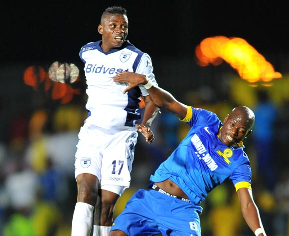 Hlompho Kekana of Mamelodi Sundowns challenged by Papy Faty of Bidvest Wits during the Absa Premiership 2014/15 football match between Bidvest Wits and Mamelodi Sundowns at Bidvest Stadium in Johannesburg, South Africa on March 03, 2015