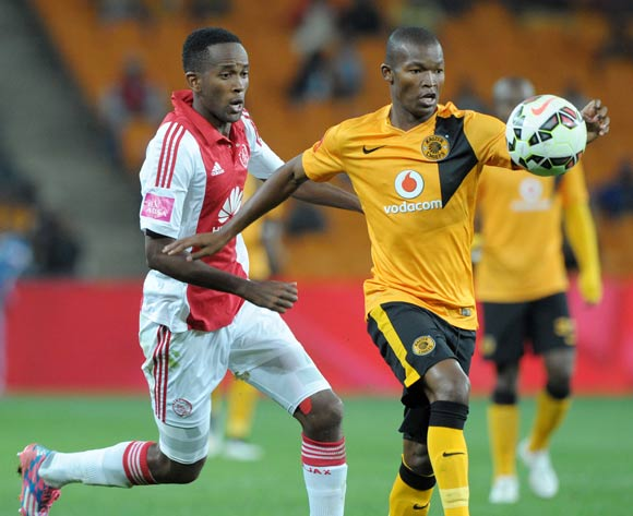 Mandla Masango of Kaizer Chiefs  challenged by Mosa Lebusa of Ajax Cape Town during the Absa Premiership 2014/15 match between Kaizer Chiefs and Ajax Cape Town at the FNB Stadium, Johannesburg on the 04 March 2015
