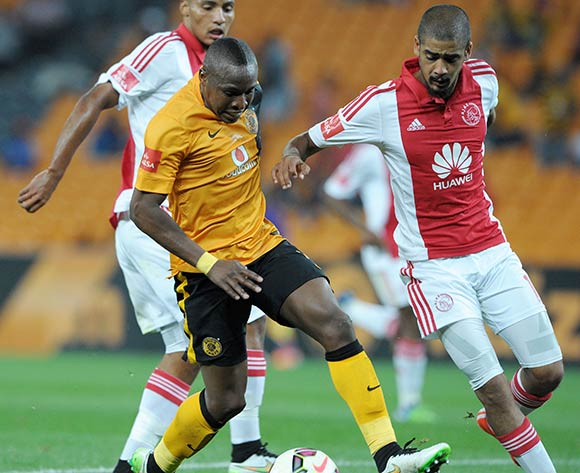 George Maluleka of Kaizer Chiefs challenged by Abbubaker Mobara of Ajax Cape Town during the Absa Premiership 2014/15 match between Kaizer Chiefs and Ajax Cape Town at the FNB Stadium, Johannesburg on the 04 March 2015  ©Muzi Ntombela/BackpagePix