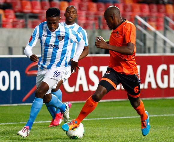 William Thwala of Chippa United (L) and Lebohang Motumi of Polokwane City (R) do battle for the ball during the Absa Premiership football Match between Chippa United and Polokwane City  at the Nelson Mandela Bay Stadium on 4 March 2015