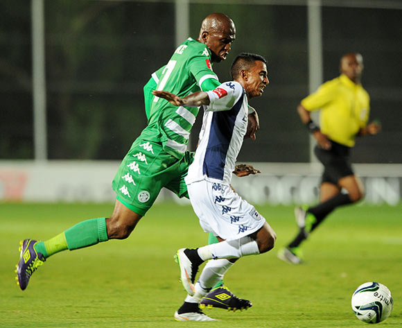 Sameehg Doutie of Bidvest Wits battles with Alfred Ndengane of Bloemfontein Celtic during the Absa Premiership 2014/15 match between Bidvest Wits and Bloemfontein Celtics at the Bidvest Stadium, Johannesburg on the 06 March 2015  ©Muzi Ntombela/BackpagePix