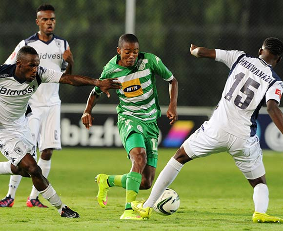 Thapelo Morena of Bloemfontein Celtic challenged by Buhle Mkhwanazi and Onismor Bhasera of Bidvest Wits during the Absa Premiership 2014/15 match between Bidvest Wits and Bloemfontein Celtics at the Bidvest Stadium, Johannesburg on the 06 March 2015  ©Muzi Ntombela/BackpagePix