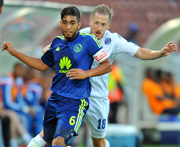 Travis Graham of Ajax Cape Town challenged by Michael Morton of Supersport United during the Absa Premiership 2014/15 football match between Supersport United and Ajax Cape Town at the Peter Mokaba Stadium in Polokwane, South Africa on March 07, 2015 ©Samuel Shivambu/BackpagePix