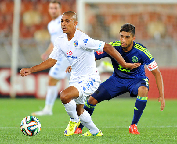 Ryan Chapman Supersport United challenged by Travis Graham of Ajax Cape Town during the Absa Premiership 2014/15 football match between Supersport United and Ajax Cape Town at the Peter Mokaba Stadium in Polokwane, South Africa on March 07, 2015 ©Samuel Shivambu/BackpagePix