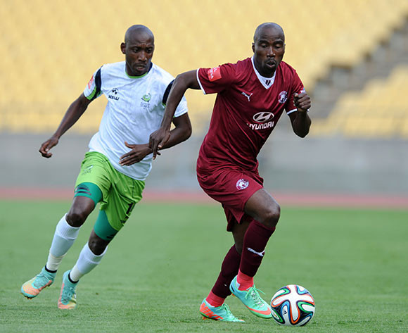 Siyabonga Nomvethe of Moroka Swallows challenged by Tintswalo Tshabalala of Platinum Stars during the Absa Premiership 2014/15 match between Platinum Stars and Moroka Swallows at the Royal Bafokeng Stadium, Rustenburg on the 08 March 2015  ©Muzi Ntombela/BackpagePix