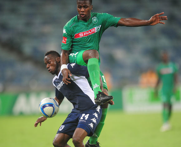 Bonginkosi Ntuli of AmaZulu battles Onismor Bhasera of Bidvest Wits during the Absa Premiership 2014/15 football match between AmaZulu and Bidvest Wits at the Moses Mabhida Stadium in Durban Kwa-Zulu Natal on the 10th of March  2015