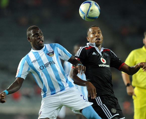 Siyabonga Zulu of Chippa United battles with Happy Jele of Orlando Pirates during the Absa Premiership match between Orlando Pirates and Chippa United on 10 March 2015 at Orlando Stadium