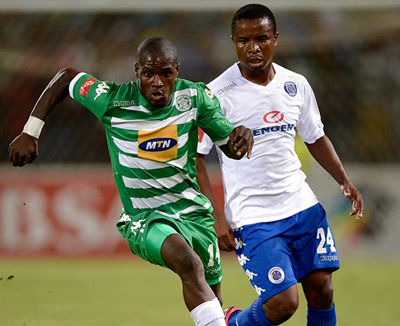Lerato Lamola of Bloemfontein Celtic and David Mathebula of Supersport United during the Absa Premiership match between Bloemfontein Celtic FC and Supersport United FC at the Free State Stadium  on 11 March 2015
