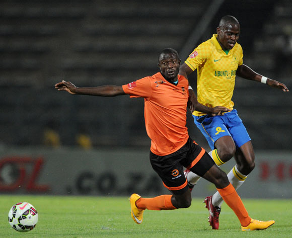 Esau Kanyenda of Polokwane City fouled by Hlompho Kekana of Mamelodi Sundowns during the Absa Premiership 2014/15 match between Mamelodi Sundowns and Polokwane City at the Lucas Moripe Stadium, Attridgeville on the 11 March 2015