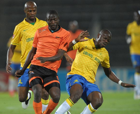 Esau Kanyenda of Polokwane City tackled by Hlompho Kekana of Mamelodi Sundowns during the Absa Premiership 2014/15 match between Mamelodi Sundowns and Polokwane City at the Lucas Moripe Stadium, Attridgeville on the 11 March 2015