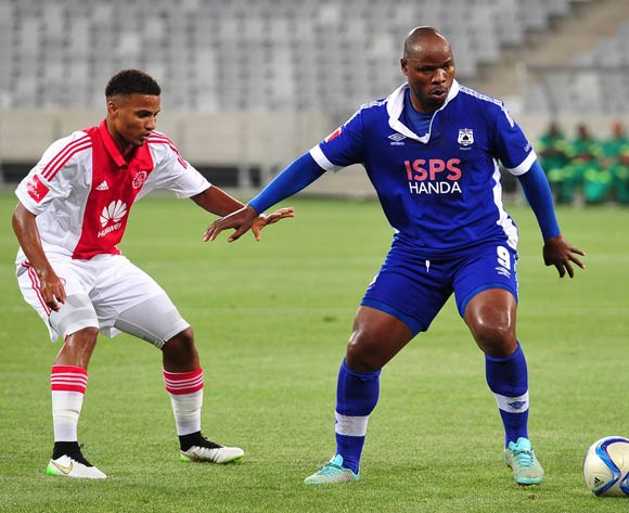 Collins Mbesuma of Mpumalanga Black Aces holds off Rivaldo Coetzee of Ajax Cape Town during the Absa Premiership 2014/15 game between Ajax Cape Town and Black Aces at Cape Town Stadium, Cape Town on 11 March 2015