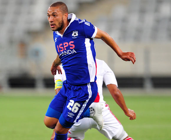 Miguel Timm of Mpumalanga Black Aces in full flight as he goes past Travis Graham of Ajax Cape Town during the Absa Premiership 2014/15 game between Ajax Cape Town and Black Aces at Cape Town Stadium, Cape Town on 11 March 2015