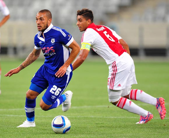 Miguel Timm of Mpumalanga Black Aces goes past Travis Graham of Ajax Cape Town during the Absa Premiership 2014/15 game between Ajax Cape Town and Black Aces at Cape Town Stadium, Cape Town on 11 March 2015