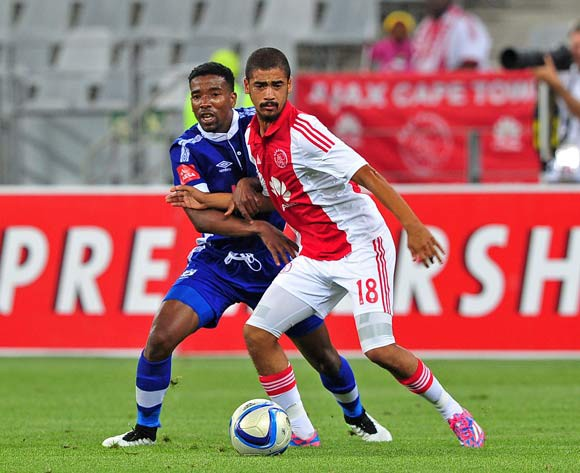 Abbubaker Mobara of Ajax Cape Town holds off the attention of Abia Nale of Mpumalanga Black Aces during the Absa Premiership 2014/15 game between Ajax Cape Town and Black Aces at Cape Town Stadium, Cape Town on 11 March 2015