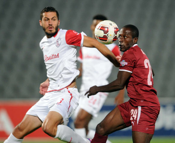Daniel Cardoso of Free State Stars battles with Felix Obada of Moroka Swallows during the Absa Premiership match between Moroka Swallows and Free State Stars on 11 March 2015 at Dobsonville Stadium