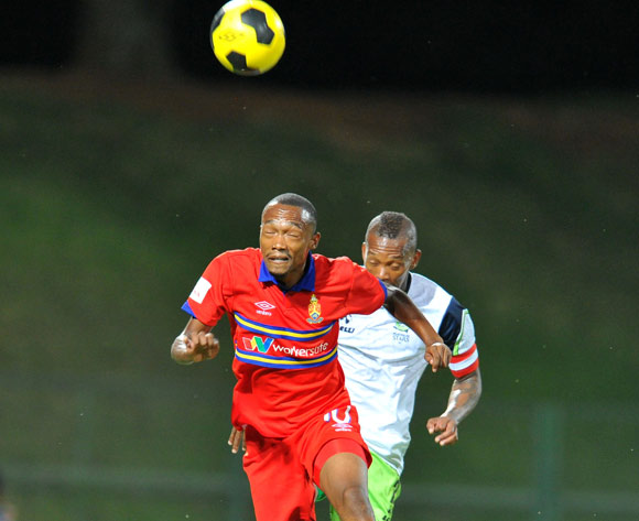 Thabo Mnyamane of University Pretoria challenged by Vuyo Mere of Platinum Stars during the 2015 Varsity Cup match between Tuks and Cut at the Tuks Stadium in Pretoria, South Africa on March 11, 2015