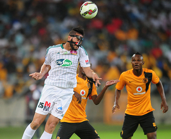 Salhi Yassine of Raja Casablanca and Reneilwe Letsholonyane of Kaizer Chiefs during the 2015 CAF Champions League football match between Kaizer Chiefs and  Raja Casablanca at the Moses Mabhida Stadium in Durban , Kwa-Zulu Natal on the 14th of March 2015  ©Sabelo Mngoma/BackpagePix