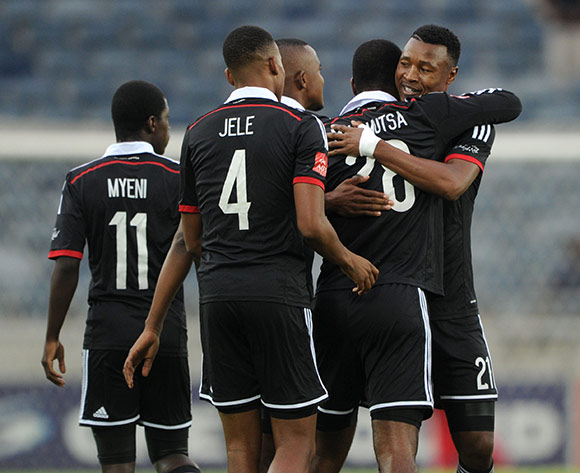 Rooi Mahamutsa of Orlando Pirates celebrates his goal with teammates during the 2015 CAF Confederations Cup match between Orlando Pirates and URA at the Orlando Stadium, Soweto on the 14 March 2015  ©Muzi Ntombela/BackpagePix