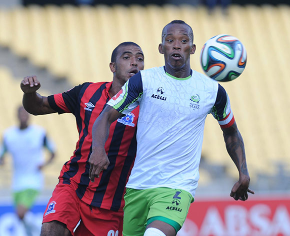 Deolin Mekoa of Maritzburg United battles with Vuyo Mere of Platinum Stars  during the Absa Premiership match between Platinum Stars and Maritzburg United on 15 March 2015 at Royal Bafokeng Stadium Pic Sydney Mahlangu/BackpagePix