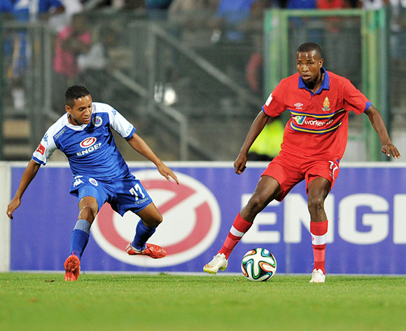 Thabo Mosadi of University Pretoria challenged by Daine Klate of Supersport United during the Absa Premiership 2014/15 football match between Supersport United and University of Pretoria at the Lucas Moripe Stadium in Pretoria, South Africa on March 14, 2015 ©Samuel Shivambu/BackpagePix