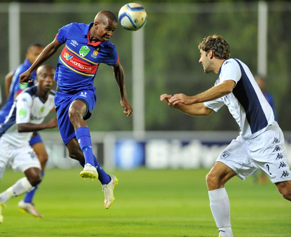 Thabo Mosadi of University Pretoria challenged by Cornelis Kwakman of Bidvest Wits during the Nedbank Cup match between Bidvest Wits and University of Pretoria at the Bidvest Stadium in Johannesburg, South Africa on March 17, 2015