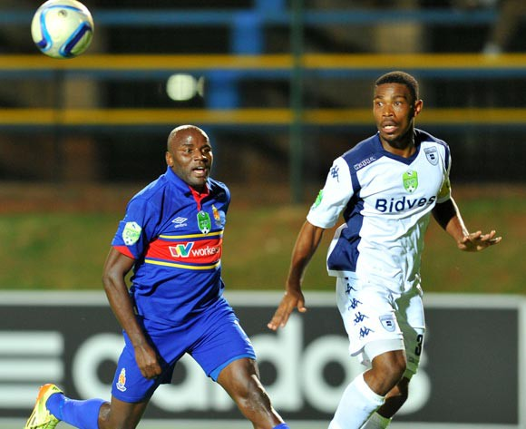 Thulani Hlatshwayo of Bidvest Wits challenged by Geofrey Massa of University Pretoria during the Nedbank Cup match between Bidvest Wits and University of Pretoria at the Bidvest Stadium in Johannesburg, South Africa on March 17, 2015